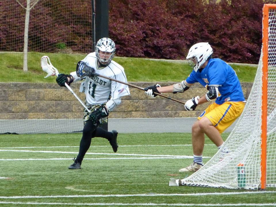 Dan Balok starts his move from behind the goal against a long pole defenseman from San Jose State, March 26, 2015.